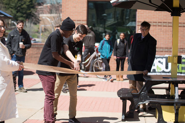 Solar charging station ribbon-cutting draws lunchtime crowd at Appalachian's Peacock Hall